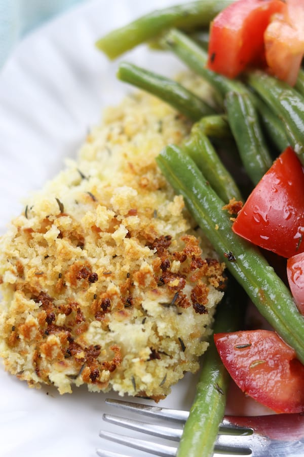 A sheet pan dinner with herby panko chicken and baked green beans that are easily dressed into a salad. Light and healthy, this is a perfect week night dinner.
