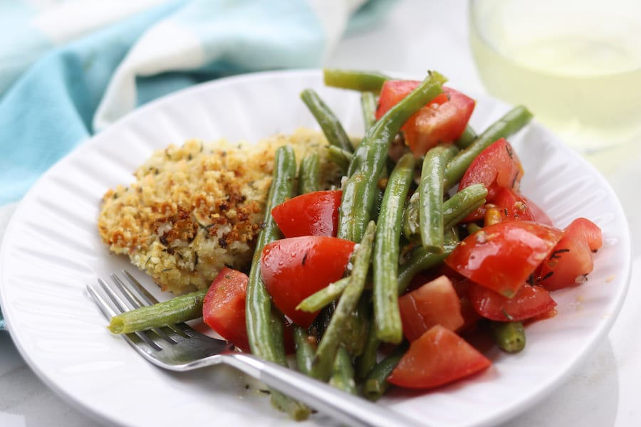 One Pan Panko Chicken and Green Bean Salad recipe is a sheet pan dinner with herby panko chicken and baked green beans that are easily dressed into a salad. Light and healthy, a perfect week night dinner.
