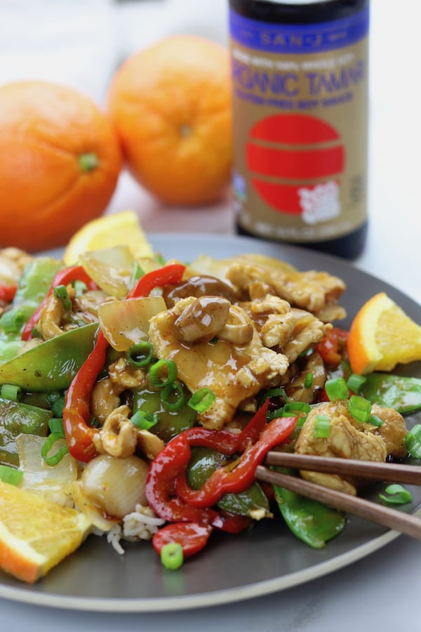 Citrus Chicken Stir Fry recipe is clean eating at its best. Stir fried veggies and chicken are covered in a savory soy orange sauce. A family favorite recipe that comes together in less than 30 minutes.