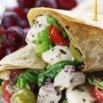 Creamy Italian Chicken Salad Wrap recipe is an easy and delicious meal. A whole wheat tortilla holds baked chicken, mozzarella cheese, veggies and a homemade creamy Italian dressing. Always a favorite as a make ahead lunch!