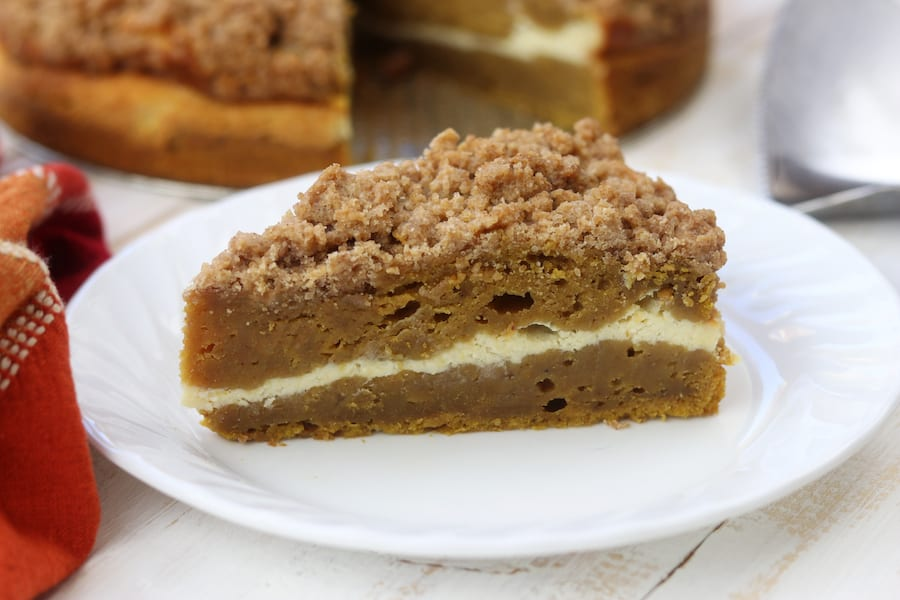 Moist and rich with the best buttery crumble topping, this Pumpkin Pie Coffee Cake recipe is a cross between two classic desserts. Add in the cream cheese layer and this becomes a favorite fall dessert!