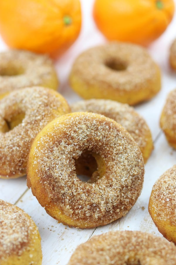 Orange Spiced Pumpkin Cake Donuts is an easy, family favorite recipe that will delight your taste buds. Hints of refreshing orange are nestled in fluffy pumpkin cake and top with cinnamon sugar. Made with healthy ingredients, this is one of the best baked donuts ever!
