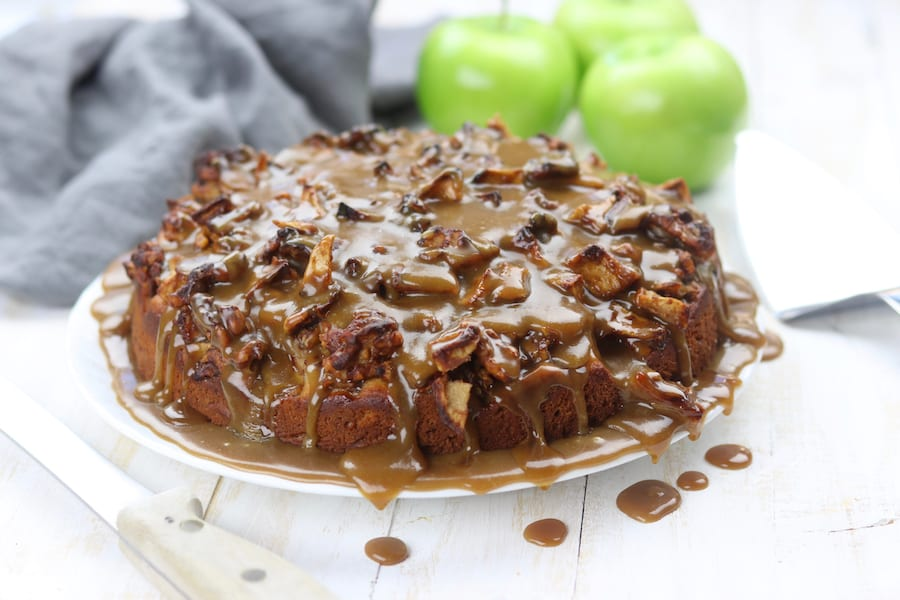 Chunky Apple Caramel Cake recipe has multiple textures that makes this baked treat feel similar to an apple fritter. A buttery caramel topping is poured over the chunky apples and walnuts making it a favorite Fall dessert.
