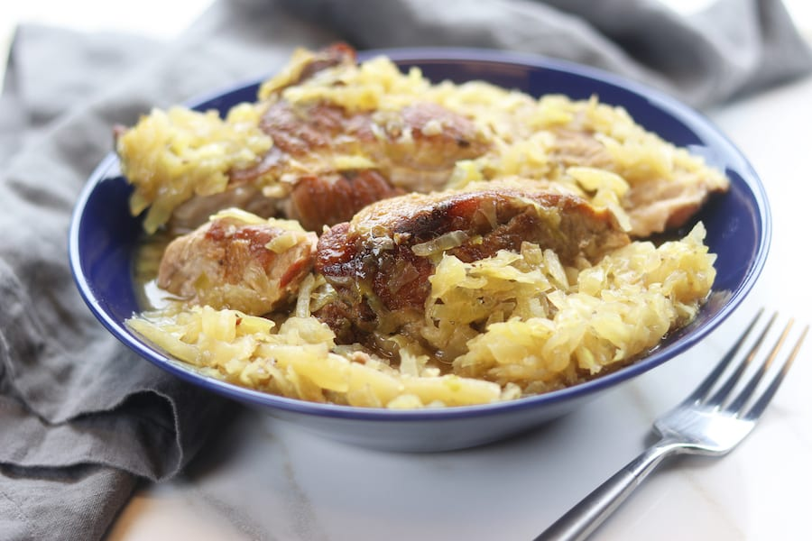 An absolute comfort meal, Country Style Pork Spare Ribs and Sauerkraut recipe creates extremely tender caramelized pork nestled into tangy sauerkraut. With just 3 ingredients and 2 steps this family favorite recipe is an extremely easy slow cooked meal.