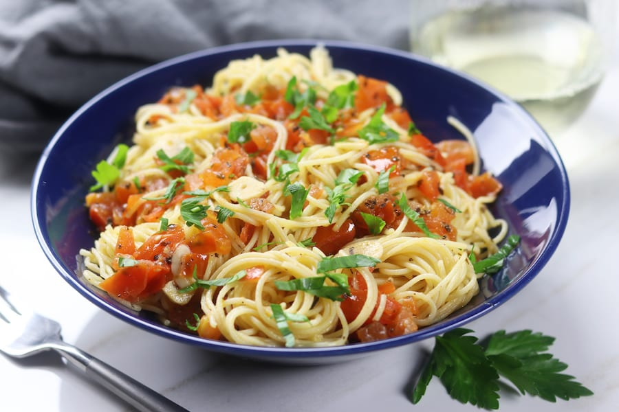 Simple Angel Hair Pasta recipe has only 5 ingredients but feels like an Italian feast. Add your favorite protein or leave as is for a favorite vegetarian meal. Perfect for a quick and easy dinner.