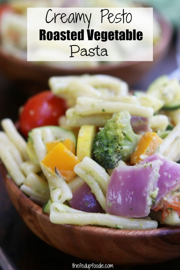 Creamy Pesto Vegetable Pasta recipe is a quick Mediterranean dinner and delicious way to eat veggies that are in season. Made with roasted veggies, pesto and goat cheese, it is a perfect solution for healthy lunch meal prep. My family devoured the first batch and I immediately made more. #PestoPasta #Pasta https://www.thefedupfoodie.com