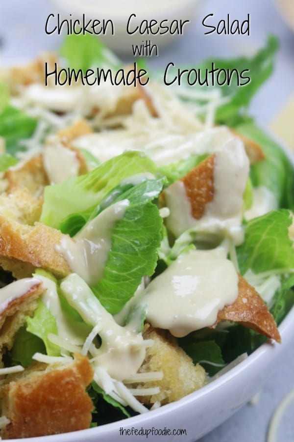 Crisp, refreshing and filling! This Chicken Caesar Salad with Homemade Croutons recipe has an easy dressing made with yogurt and no eggs. With shredded chicken this is one of my favorite summer meals. #CaesarSalad #ChickenSalad https://www.thefedupfoodie.com