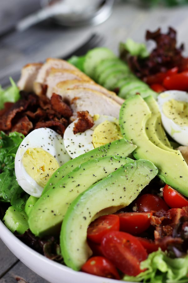 Undressed Chicken Avocado and Bacon Salad Recipe with pepper.
