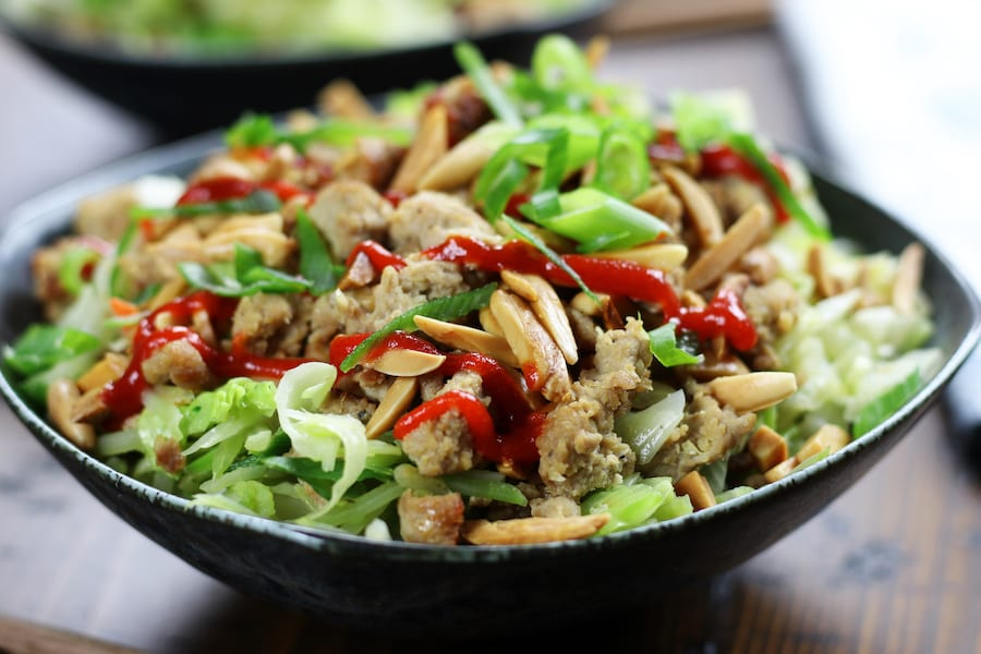 Chicken and Cabbage Stir Fry with sesame toasted almonds and sriracha.