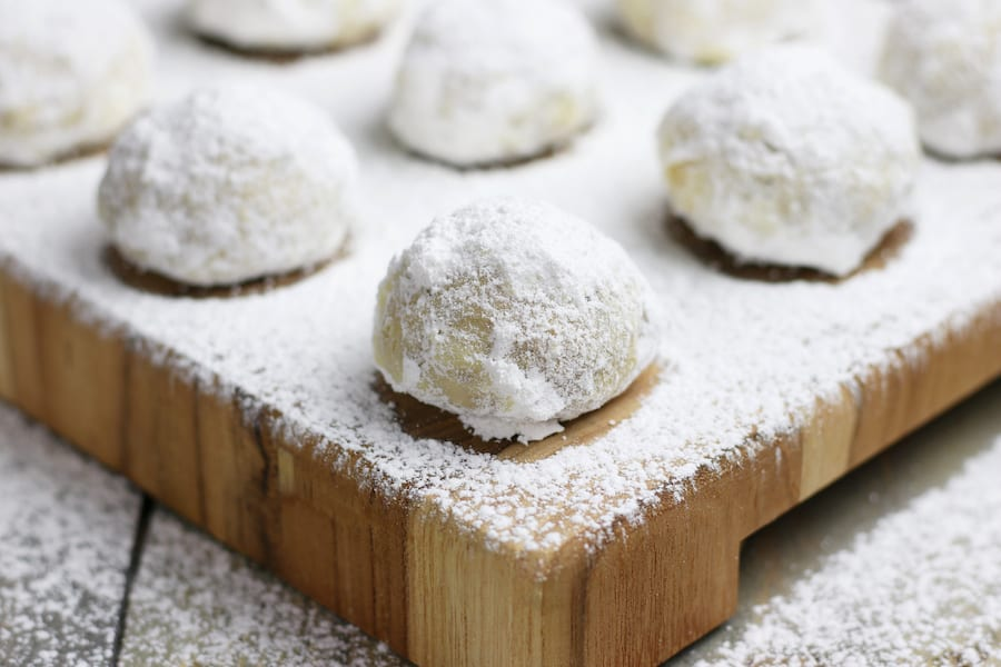 Christmas Cookies with Cranberry Orange flavor and dusted with powdered sugar.