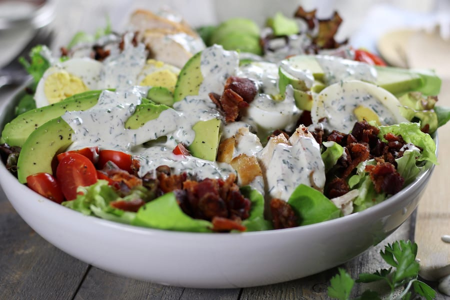 Large salad with Keto Ranch Dressing on top.