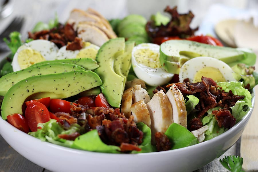 Low Carb Chicken Salad Recipe undressed in a large salad bowl.
