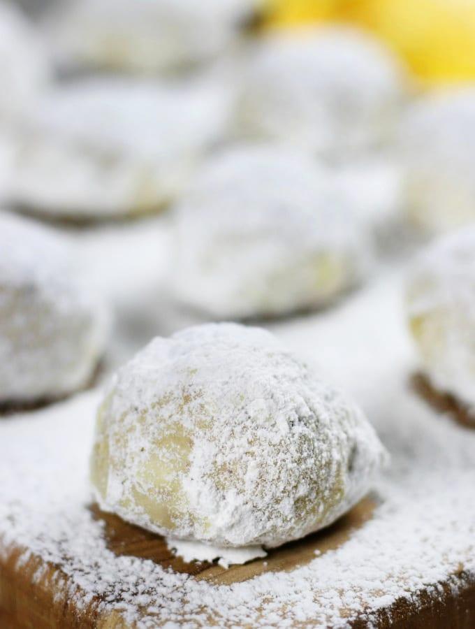 Orange Cranberry Walnut Balls sprinkled and rolled in powdered sugar.