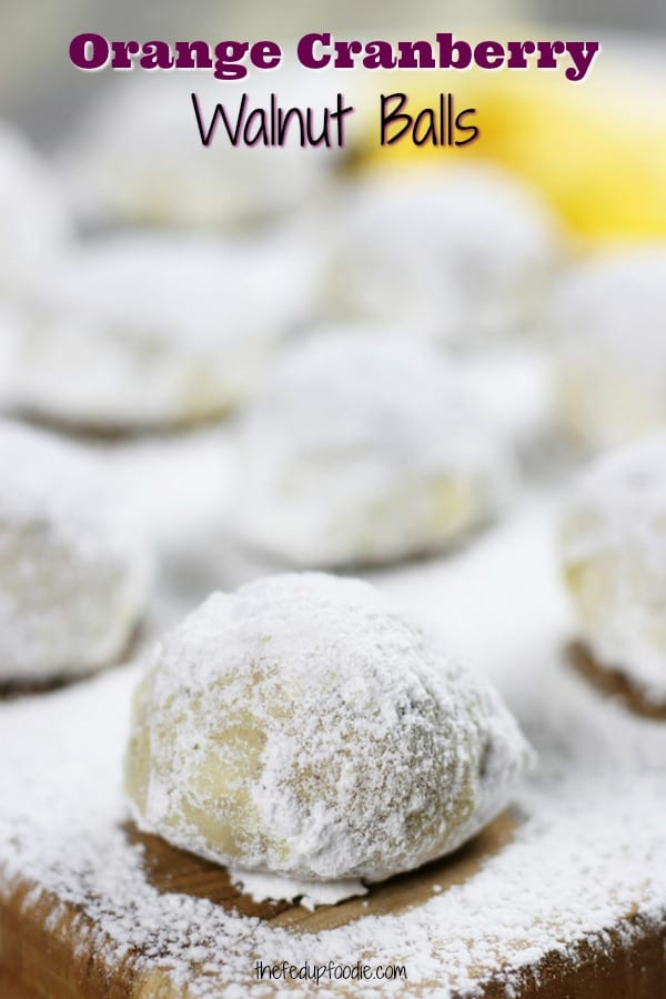 Orange Cranberry Walnut Balls are like classic walnut balls but with a twist. Bright aromatic orange and studded with cranberries, these Christmas cookies are a festive way to celebrate the holidays. #ChristmasCookie #Cookie https://www.thefedupfoodie.com