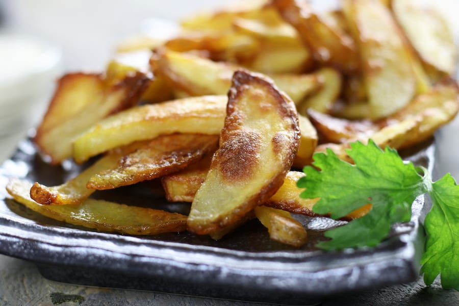 Several Homemade Baked French Fries on a plate.