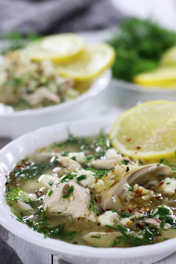 Lemon Chicken Soup Recipe with lemon slices.