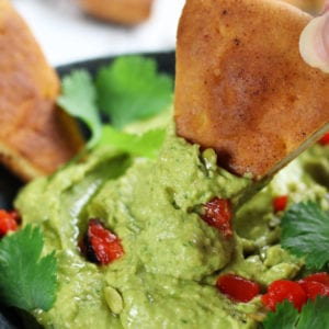 A bowl of Avocado Hummus with Cumin and Cilantro.