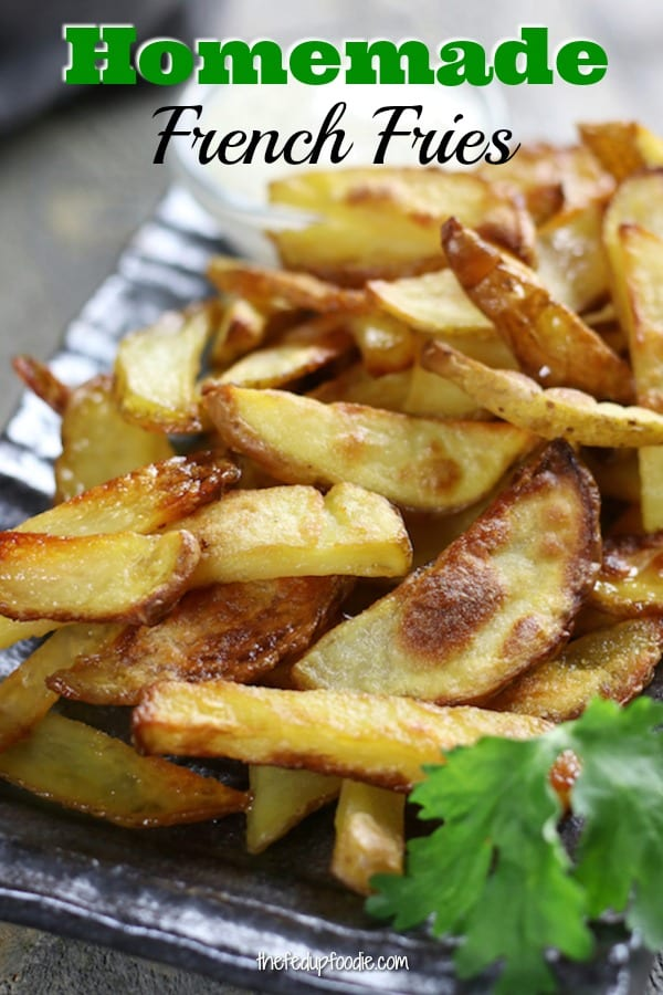 Crispy oven baked Homemade French fries recipe. Learn the secrets to perfectly seasoned andcompletely addictive fries. Made with simple, quality ingredients. So good! My family loves these! #BakedFrenchFries #FrenchFryRecipe #CrispyBakedFries https://www.thefedupfoodie.com
