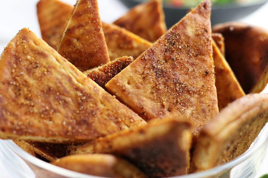 Several Sea Salt and Spice Pita Chips in a bowl.