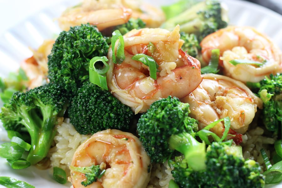 Up close photo of Shrimp Broccoli Stir Fry with green onions.