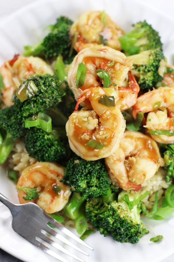 Shrimp Stir Fry with broccoli and rice on a white plate.