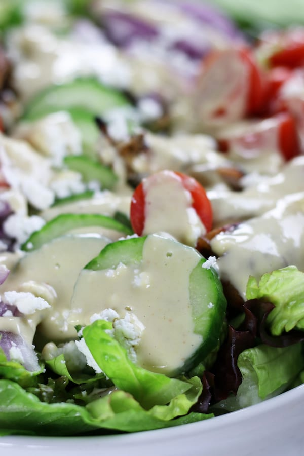 Creamy Lemon Dressing on top of a salad.