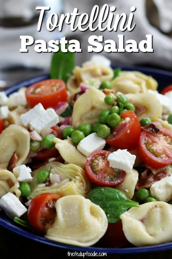 A family Favorite cold meal during the hot summer months. This Bacon Belly Button Pasta Salad (aka. Tortellini Salad) is a zesty and an incredibly delicious pasta dish. Light and yet very satisfying, this always disappears extremely fast! #TortelliniPastaSalad #ColdPasta #EasyPastaSalad #ItalianPastaSalad https://www.thefedupfoodie.com
