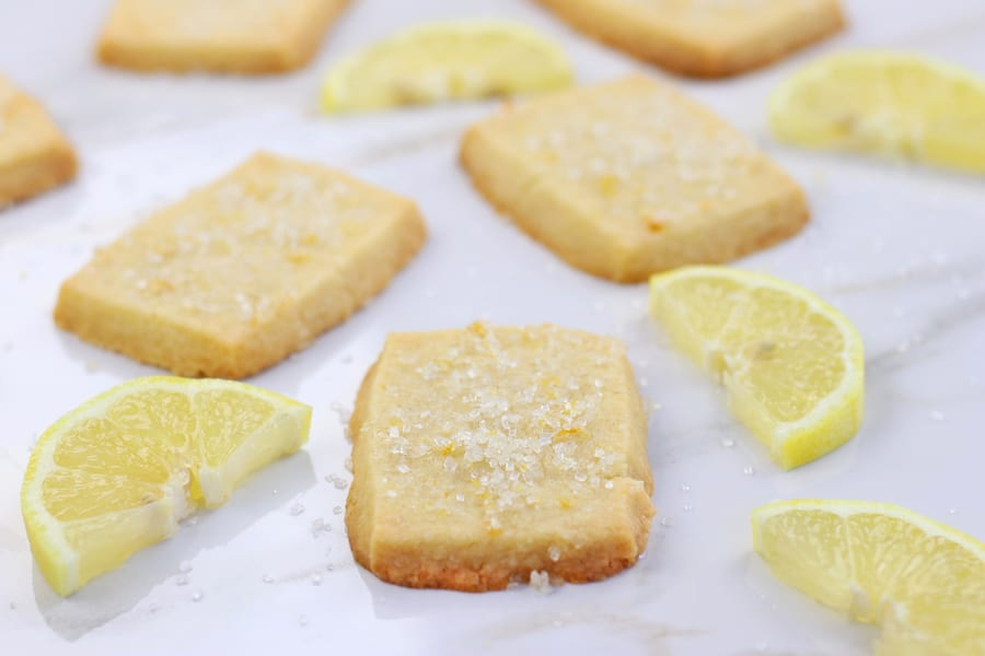 Best Lemon Shortbread Cookies on white marble tile.