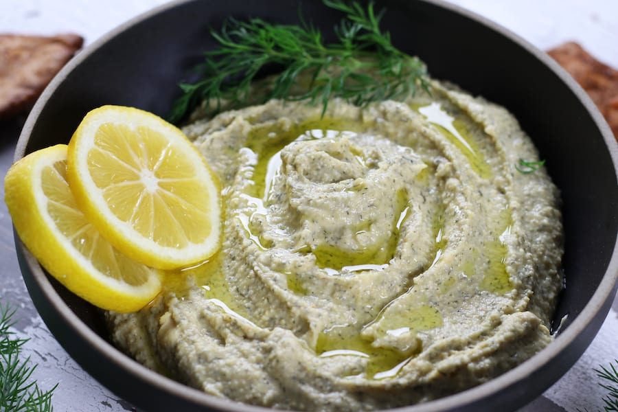 A bowl of Garbanzo Bean Hummus with lemon and fresh dill.