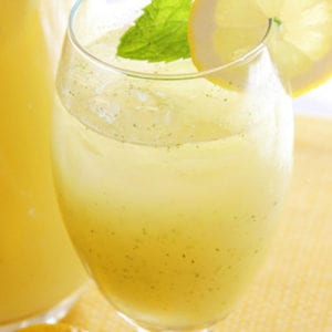 Vodka Honey Lemonade in a glass with mint and Lemon slice.