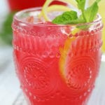 Hibiscus Pink Lemonade in an etched glass with ice.