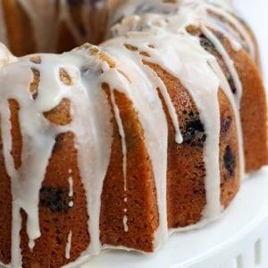 Lemon Blueberry Bundt Cake on a white cake stand.