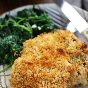 Oven Fried Pork Chops recipe with one golden pork chops served on a plate.