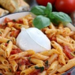 Pomodoro Pasta on penne noodles with burrata in center.