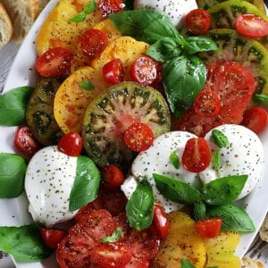 Overhead photo of a Burrata Caprese platter.