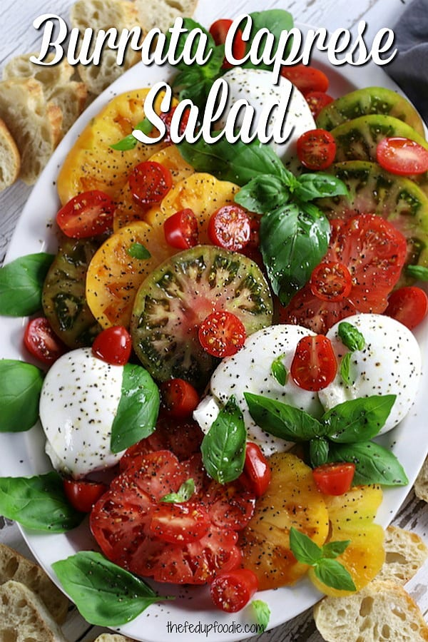 Perfect for summer, Burrata Caprese is simple and delicious salad or Italian appetizer of heirloom tomatoes, basil, mozzarella Burrata and a balsamic glaze. 