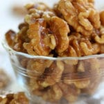 Candied Walnuts in a clear glass bowl.