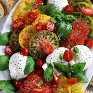 Caprese Salad with heirloom tomatoes, burrata and basil.