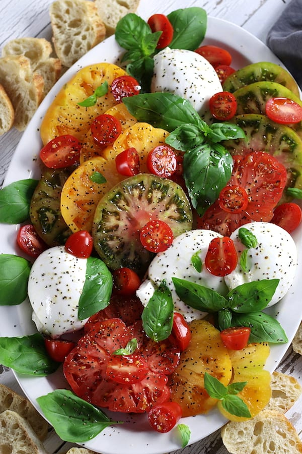 Caprese Salad with heirloom tomatoes, burrata and basil.
