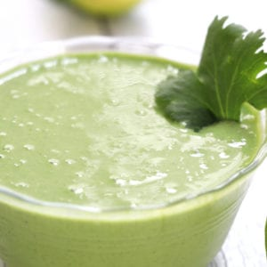 Cilantro Lime Sauce garnished with a large cilantro leaf.