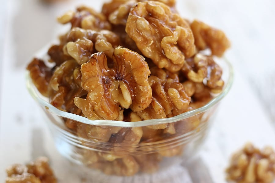 A bowl full of Glazed Walnuts.