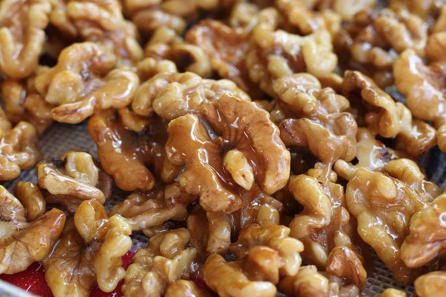 Unclose photo of Honey Glazed Walnuts spread on a cookie sheet.