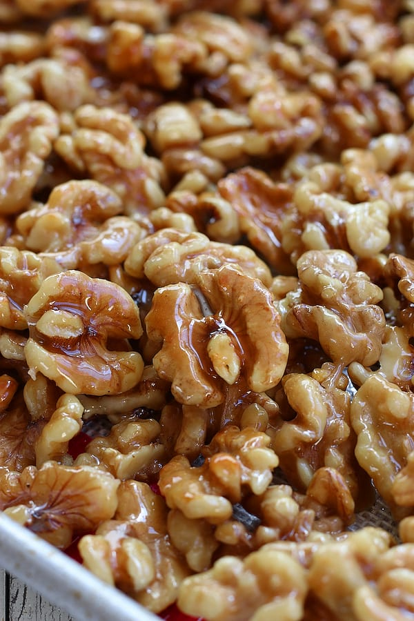 Several Honey Walnuts on a cookie sheet.