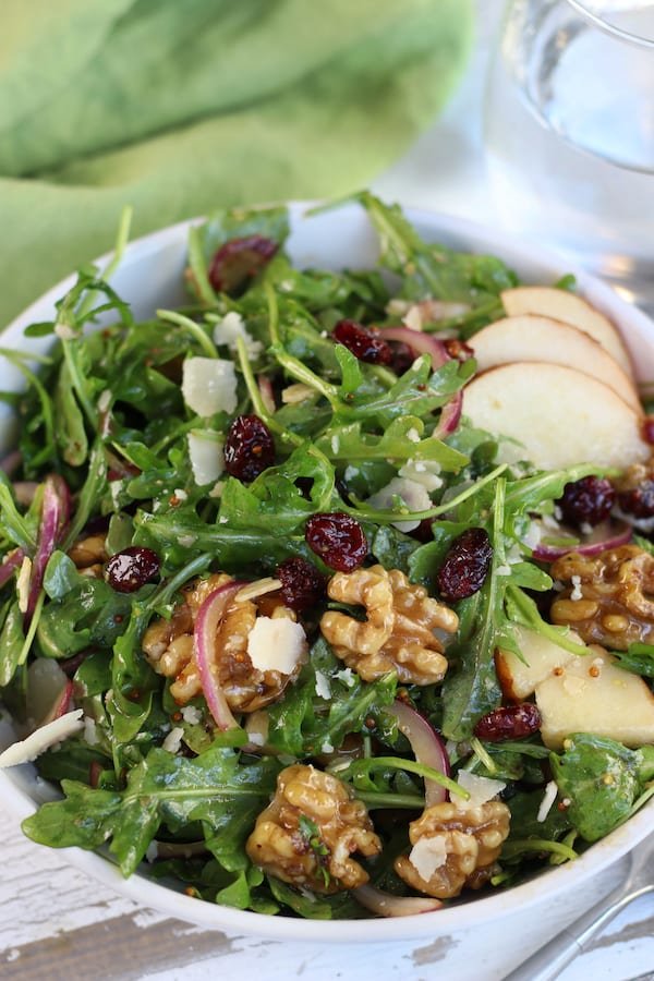 Overhead photo of Pear and Rocket Salad in a white bowl.