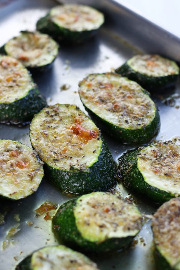 Zucchini slices from Roasted Zucchini Recipe on a cookie sheet.