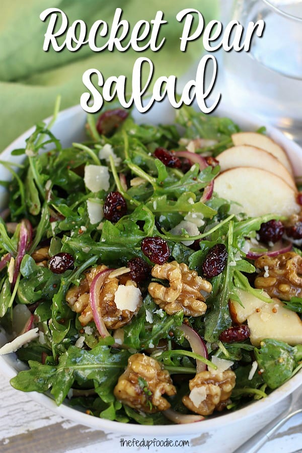 Savory and sweet, this Rocket Pear Salad is a simple and healthy recipe. Perfect as a side dish or light meal with arugula, pear, honey glazed walnuts, parmesan and a balsamic vinaigrette. So delicious and easy, this is sure to become a Fall favorite.  #RocketSaladRecipe #RocketSalad #ArugulaSalad #EasySalads #FallSalads https://www.thefedupfoodie.com/