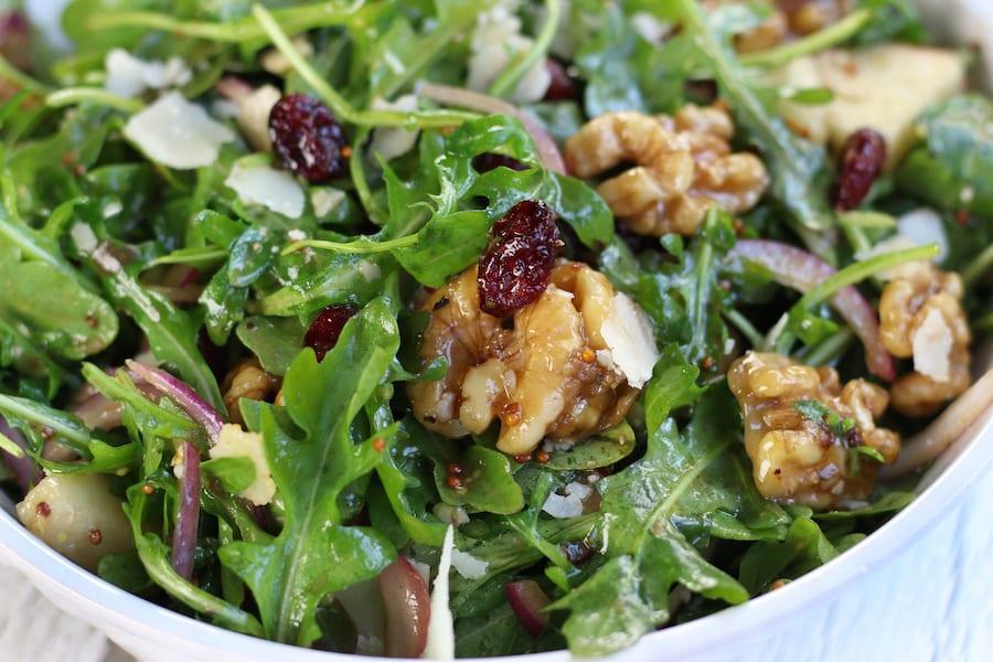 Rocket Pear Walnut Salad in a white bowl.