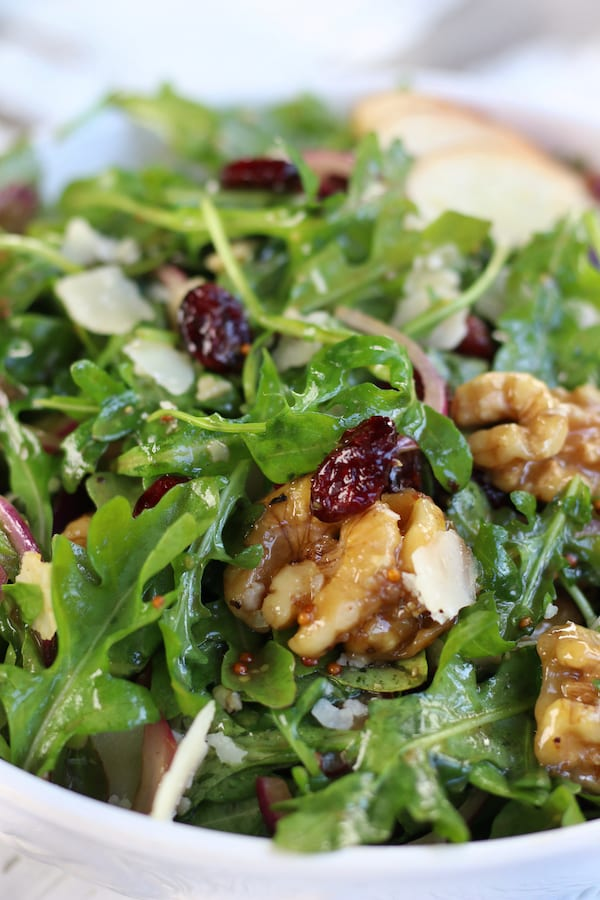 up close Rocket Salad with cranberries, pear and walnuts.