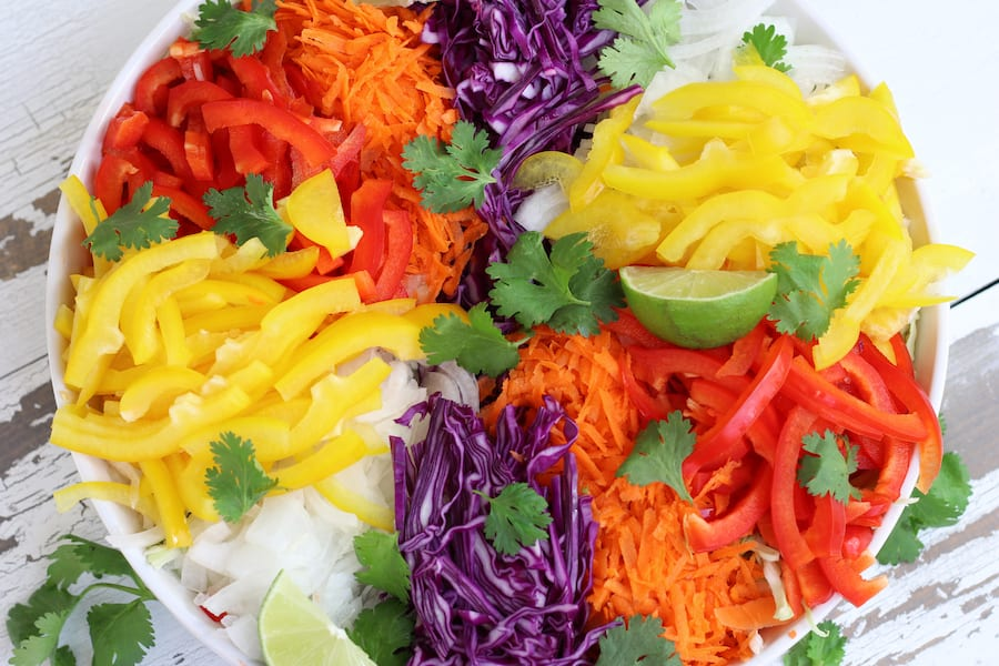 Overhead photo of shredded cabbage and chopped veggie for Vegetable Salad recipe.