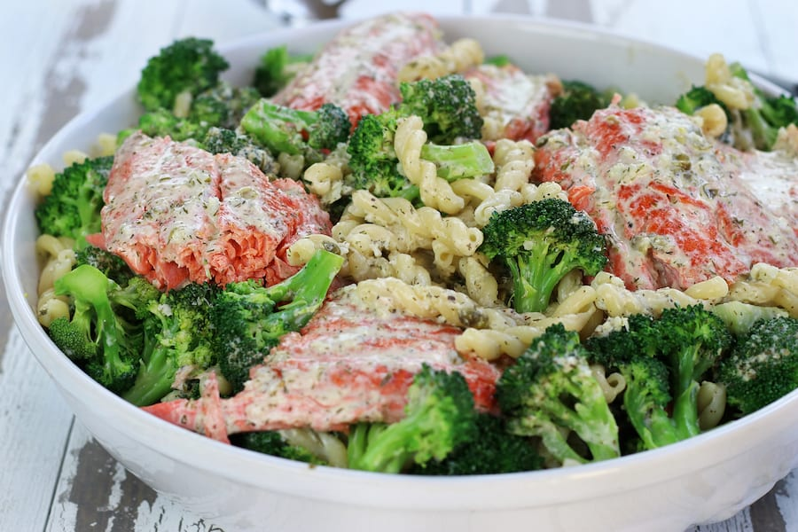 A large bowl of Creamy Salmon Pasta with broccoli.
